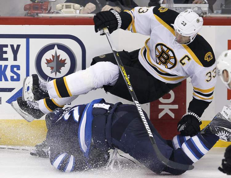 Blake Wheeler and Boston's Zdeno Chara collide during the second period. (JOHN WOODS / WINNIPEG FREE PRESS)
