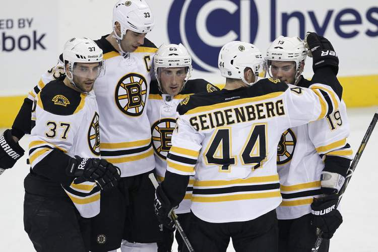 Boston Bruins' Patrice Bergeron, Zdeno Chara, Brad Marchand, Dennis Seidenberg and Tyler Seguin celebrate Seguin's goal during the second period.