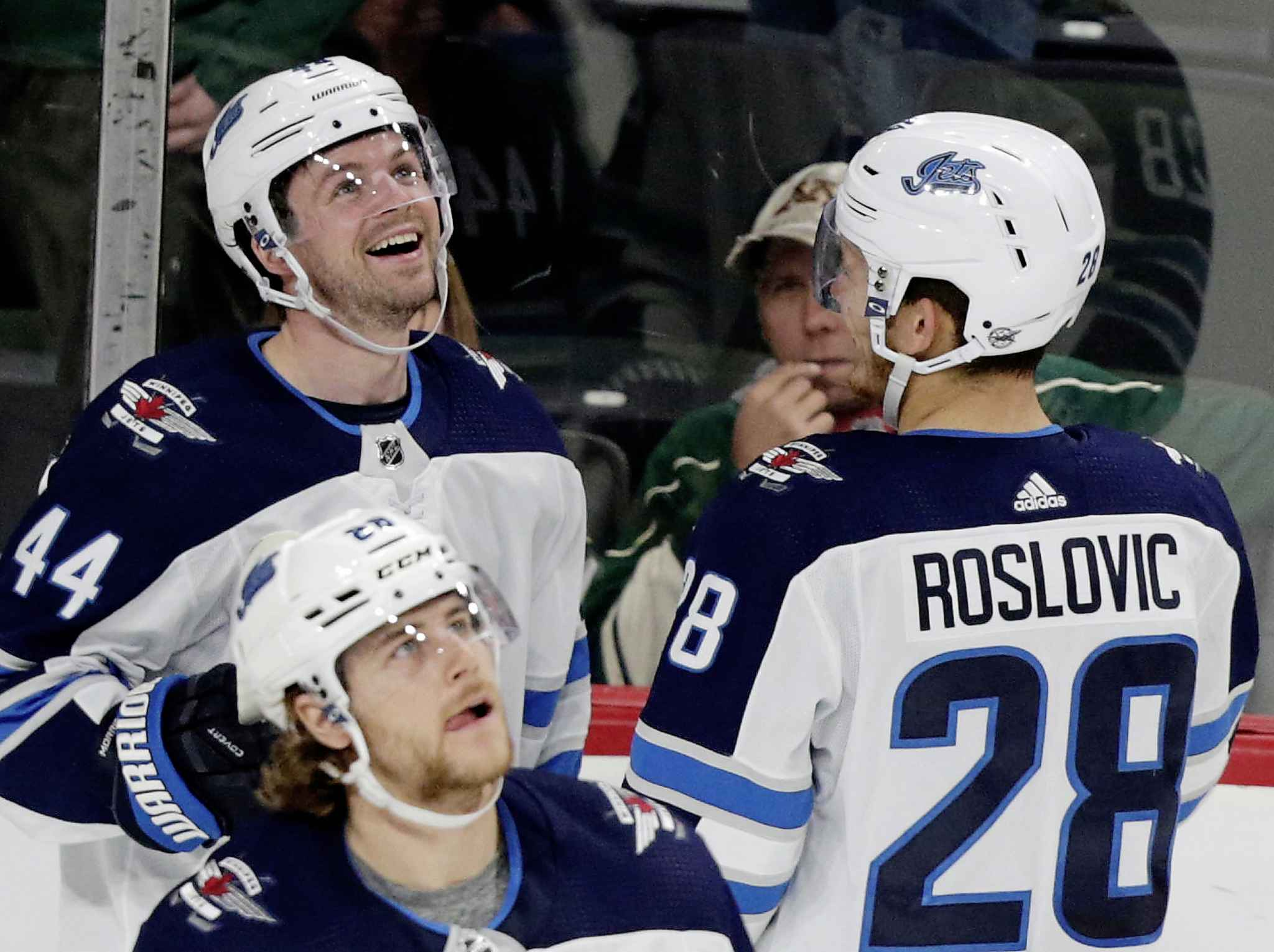 ANDY CLAYTON-KING / THE ASSOCIATED PRESS<p/> Morrissey watches his game-winner on the scoreboard as he celebrates with teammates Jack Roslovic and Nathan Beaulieu.