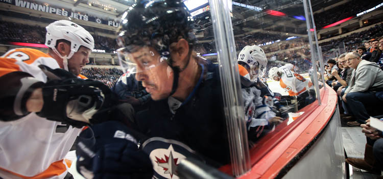 Winnipeg Jets' Alexei Ponikarovsky is crunched against the glass in the second period against the Philadelphia Flyers at MTS Centre on Tuesday night.