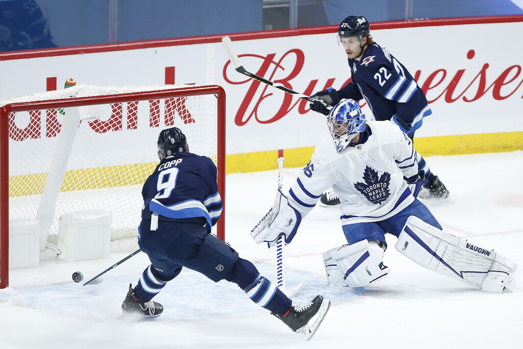 Winnipeg Jets' Andrew Copp scores on Toronto Maple Leafs goaltender Jack Campbell during the first period. THE CANADIAN PRESS/John Woods