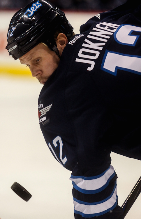 Winnipeg Jets centre Olli Jokinen eyes the puck as it drops for a face-off in the first period at MTS Centre Tuesday night.