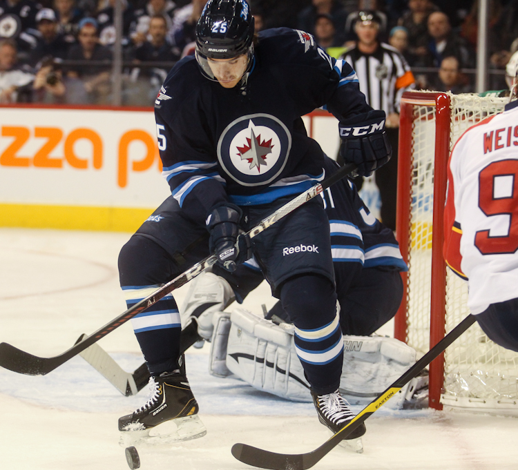 Winnipeg Jets rookie defenceman Zach Redmond eyes the puck close to the Jets' goal during the first period at MTS Centre Tuesday night. (Melissa Tait / Winnipeg Free Press)