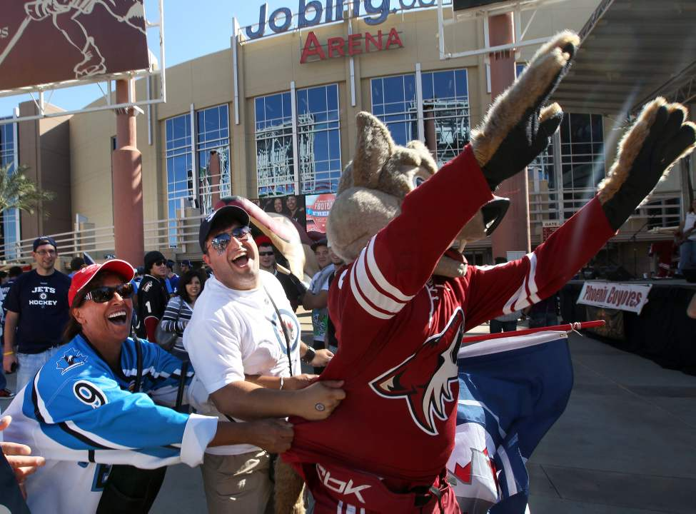 Winnipeg Jets fans have fun with Howler the Phoenix Coyotes mascot outside the Jobing.com Arena in Phoenix, Arizona Saturday prior to the start of the NHL game between the Winnipeg Jets and the Phoenix Coyotes.   (JOE BRYKSA / WINNIPEG FREE PRESS)