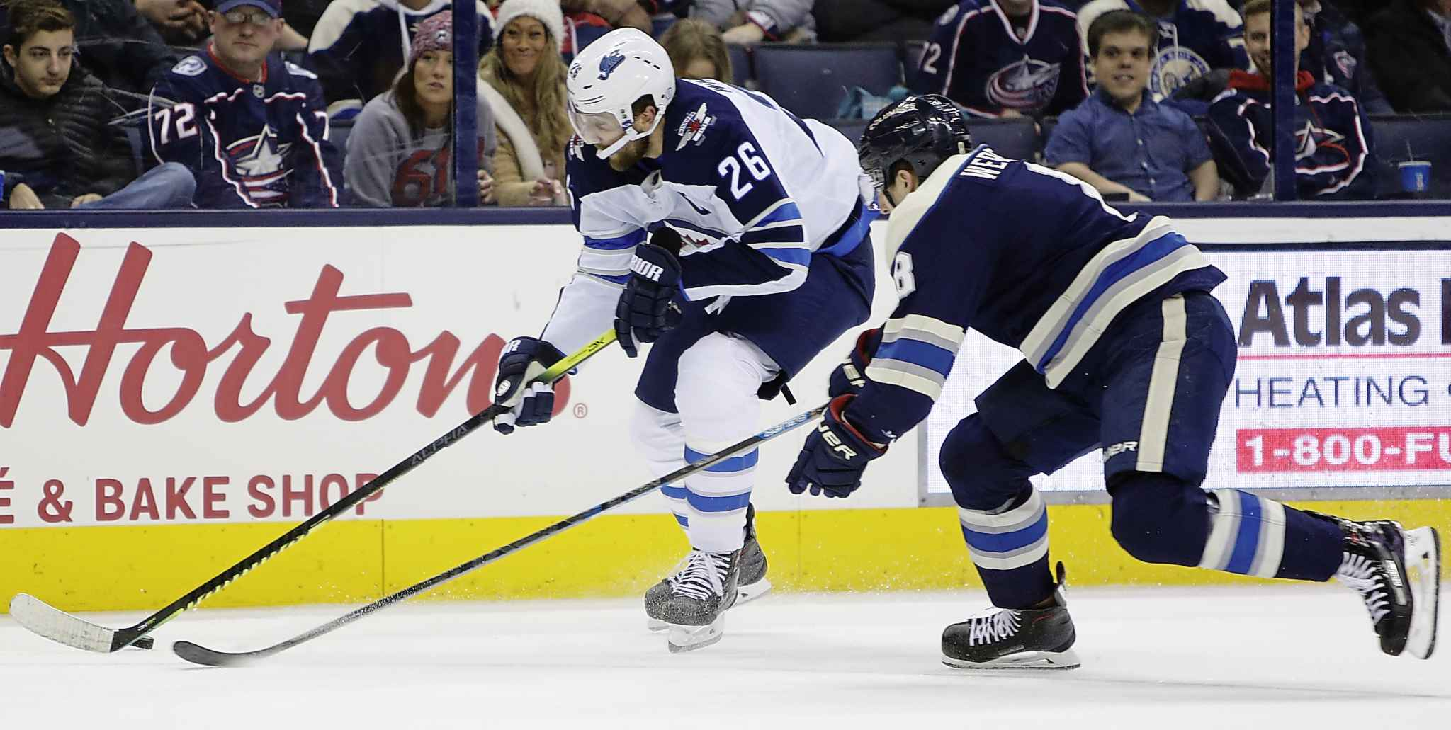 JAY LAPRETE / THE ASSOCIATED PRESS</p><p>Winnipeg Jets&#39; Blake Wheeler, left, carries the puck up ice against Columbus Blue Jackets&#39; Zach Werenski during the first period of an NHL hockey game Sunday, March 3, 2019, in Columbus, Ohio.</p>