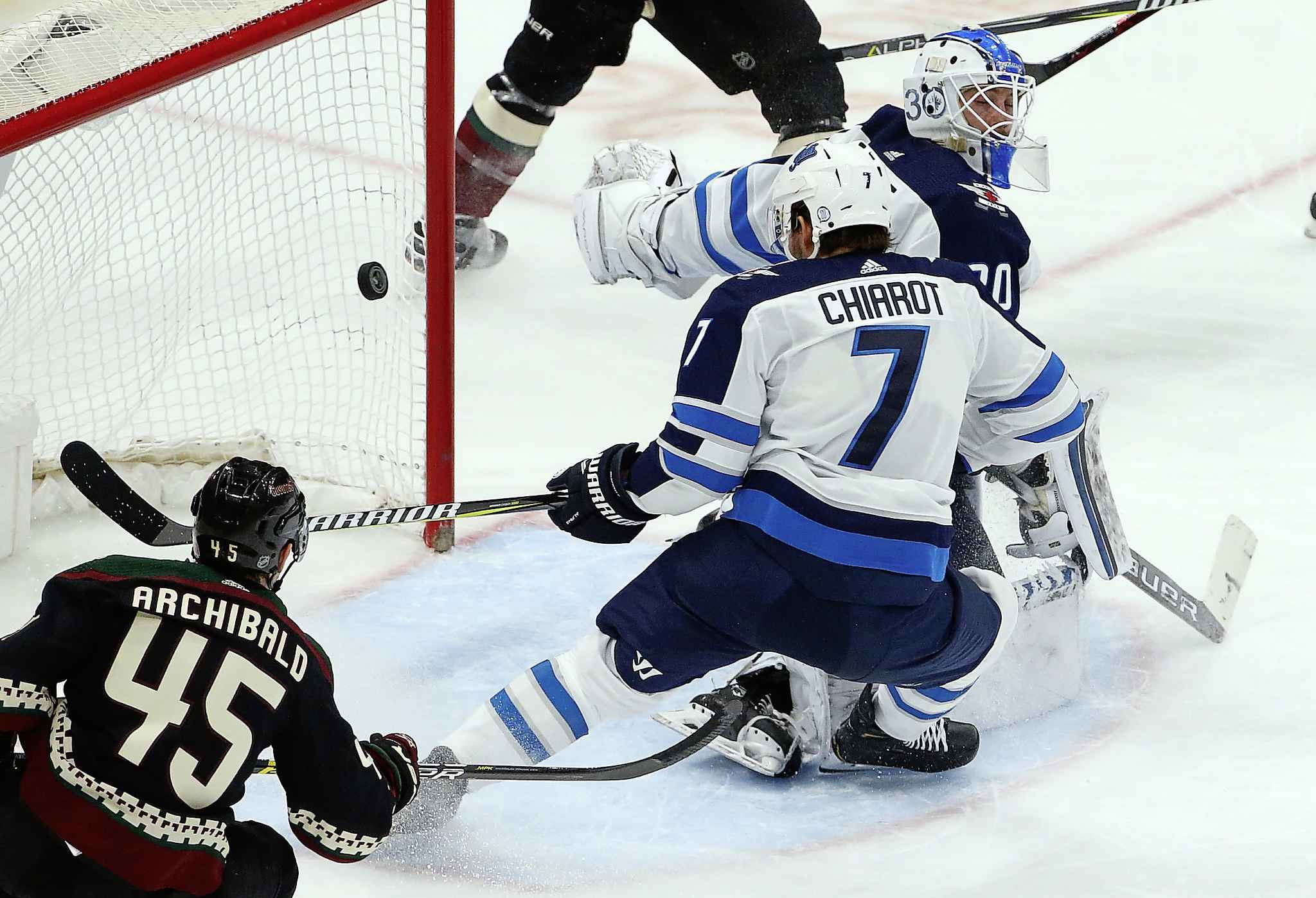 ROSS D. FRANKLIN / THE ASSOCIATED PRESS</p><p>A shot by Arizona Coyotes' Lawson Crouse goes off of Winnipeg Jets defenseman Ben Chiarot (7) and past Jets goaltender Laurent Brossoit, right, for a goal as Coyotes right wing Josh Archibald (45) looks on during the second period of an NHL hockey game Sunday, Feb. 24, 2019, in Glendale, Ariz.</p>