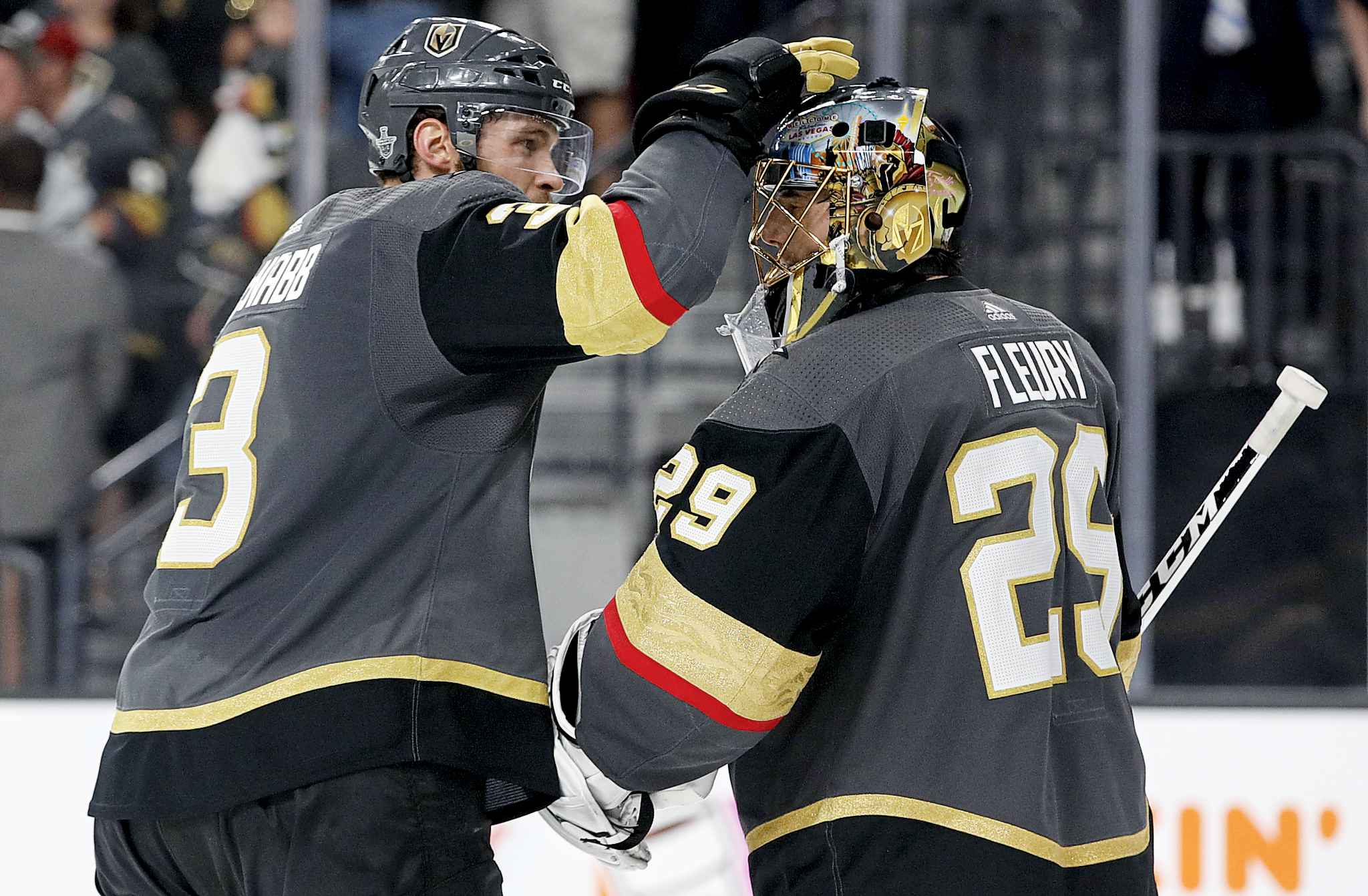 Vegas Golden Knights defenseman Brayden McNabb, left, celebrates with goaltender Marc-Andre Fleury after the team's 4-2 win against the Winnipeg Jets during Game 3 of the NHL hockey playoffs Western Conference finals Wednesday, May 16, 2018, in Las Vegas. (AP Photo/John Locher)
