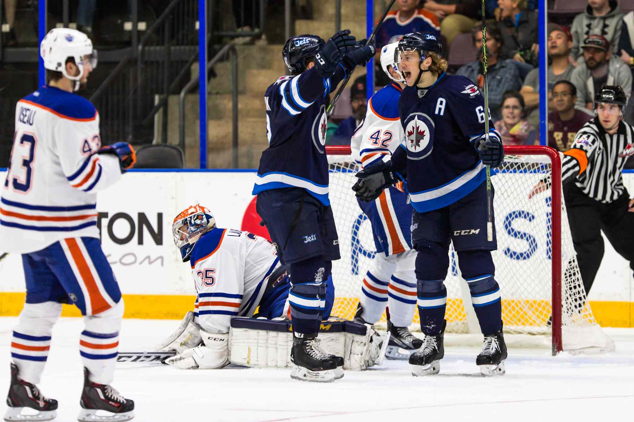 Scott Kosmachuk celebrates his game winning goal with alternate captain Ryan Olsen against the Edmonton Oilers at the South Okanagan Events Center in Penticton, B.C., this afternoon.