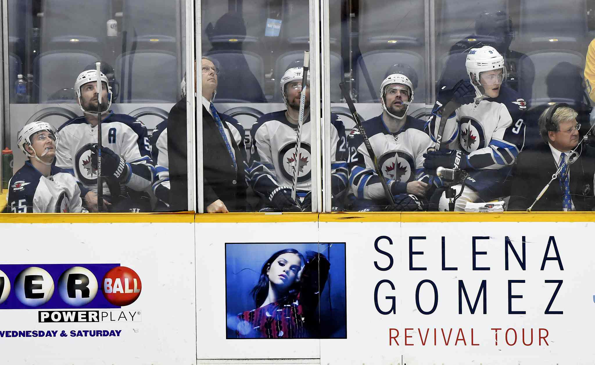 From left, Winnipeg Jets players' Mark Scheifele, Mark Stuart, Jacob Trouba (obscured), Blake Wheeler, Drew Stafford, and Andrew Copp sit in the penalty box during the third period of an NHL hockey game against the Nashville Predators, Saturday, Nov. 14, 2015, in Nashville, Tenn. The Predators won 7-0. (AP Photo/Mark Zaleski)