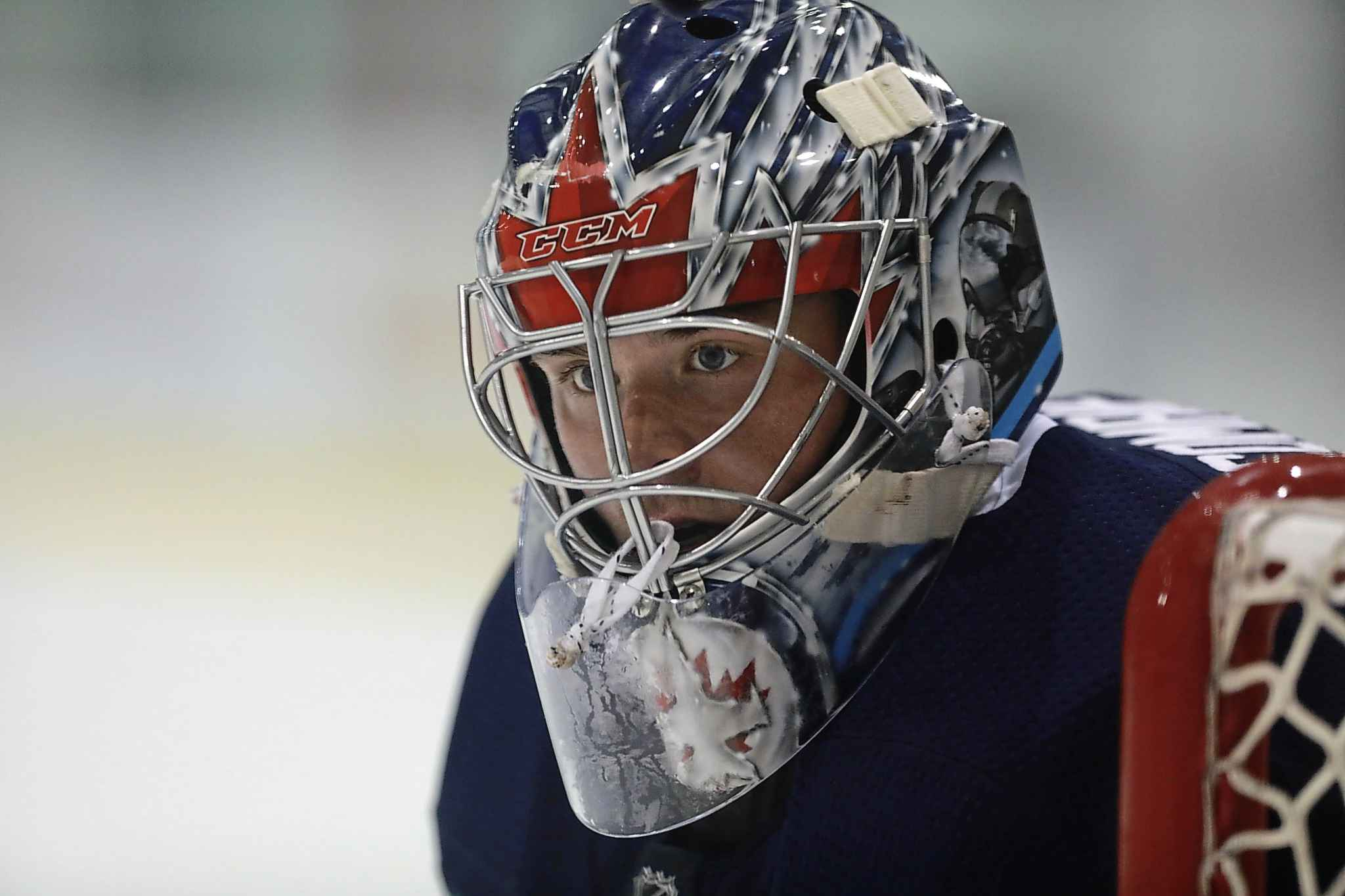 Goalie Eric Comrie in net with other members of the Jets at MTS Iceplex Tuesday.