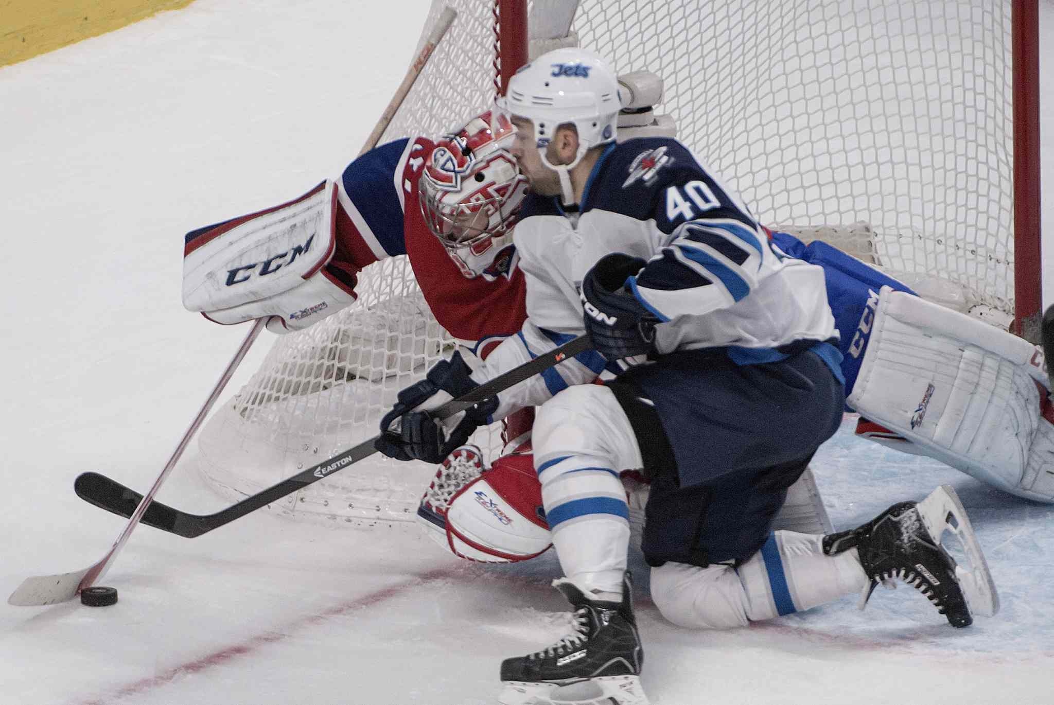 The Jets Devin Setoguchi battles Montreal Canadiens goalie Carey Price for the puck Sunday in Montreal.