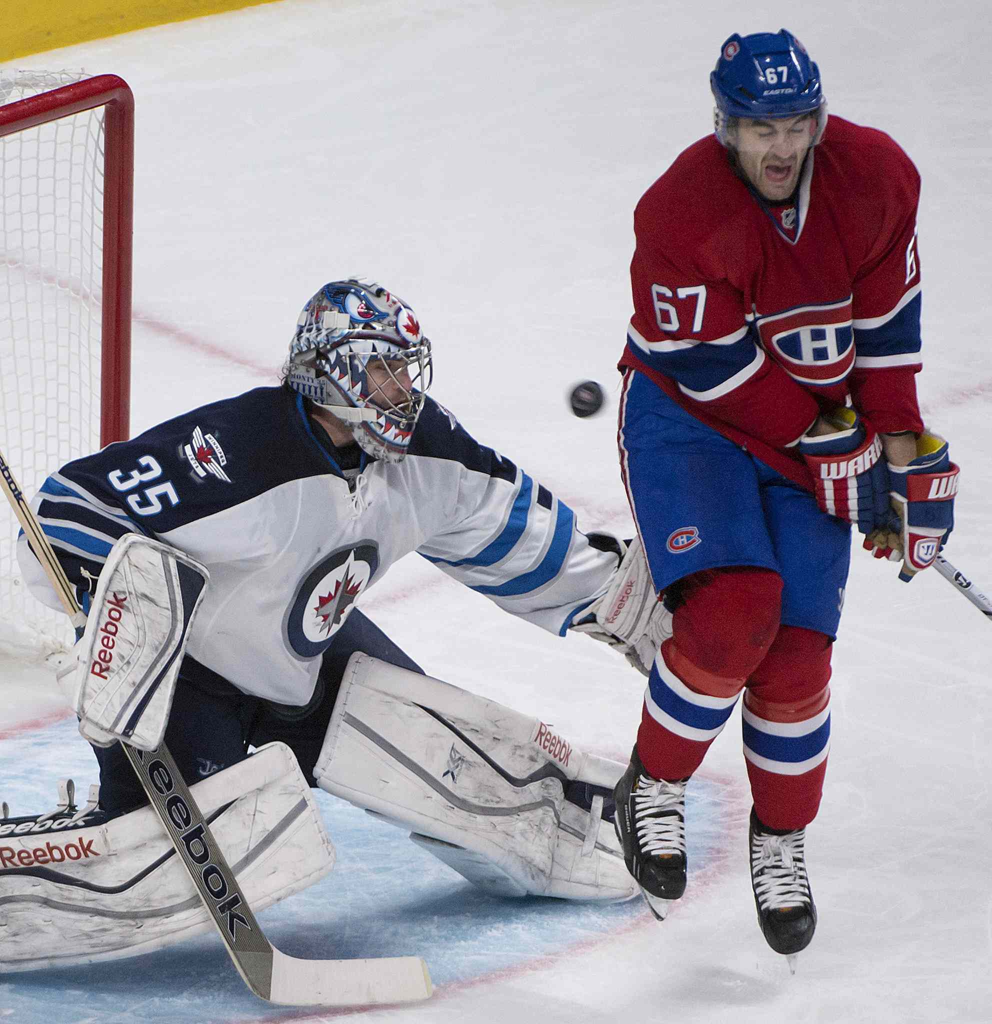 Montreal Canadien Max Pacioretty grimaces as he gets hit by the puck in front of Jets goalie Al Montoya, who was outstanding in the Jets 2-1 victory over Montreal.