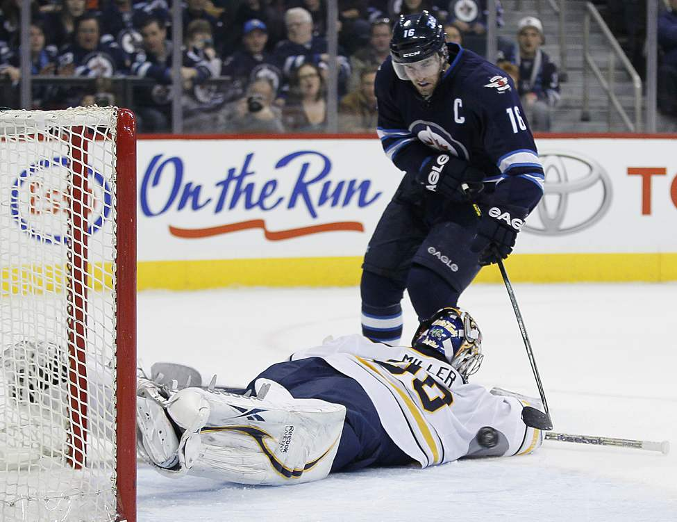 Winnipeg Jets' Andrew Ladd (16)�scores on Buffalo Sabres' goaltender Ryan Miller (30) during second period NHL action in Winnipeg. 