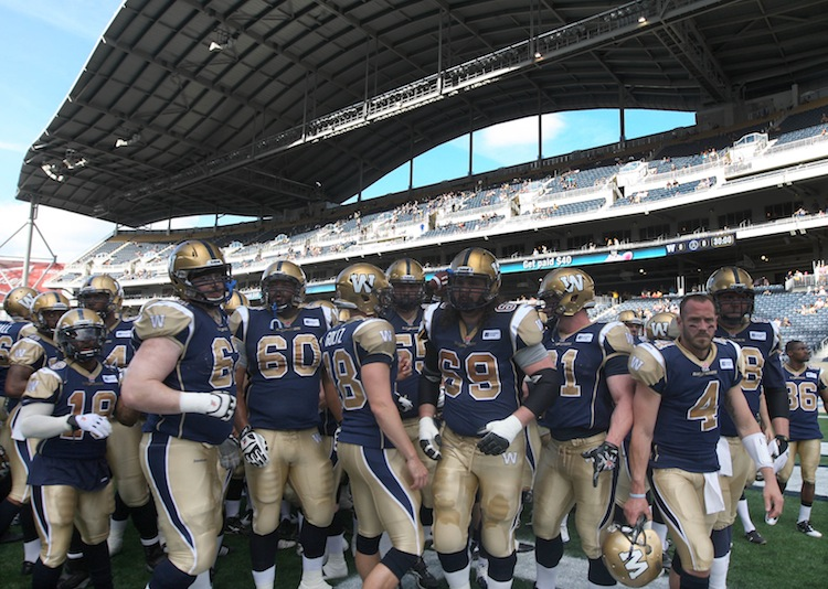 The Winnipeg Blue Bombers head off the turf following their pre-game warm-up in Investors Group Field. (JOE BRYKSA / WINNIPEG FREE PRESS)