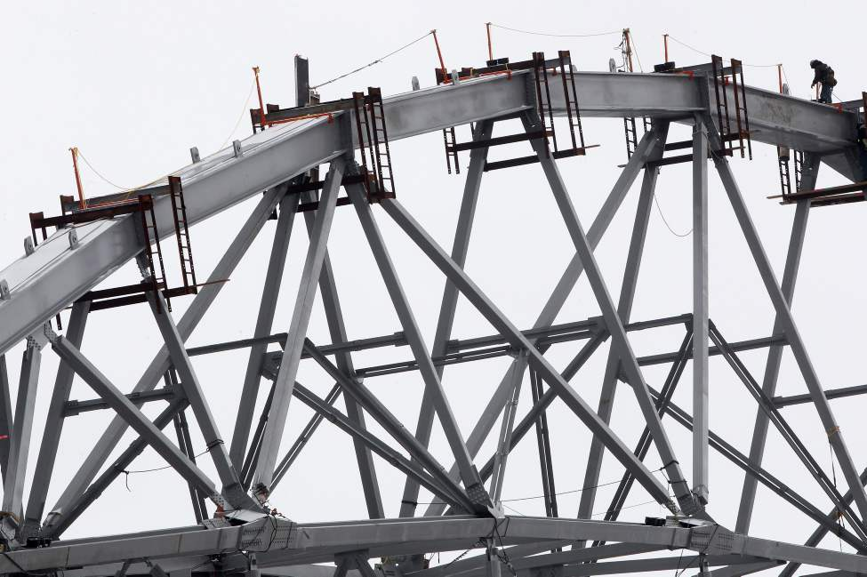 Workers align huge steel girders on the highest canopy on the East side of the new Investors Group Field stadium under construction at the University of Manitoba. The new $190 million stadium which will be home for the Winnipeg Blue Bombers will hold 33,422 people.
