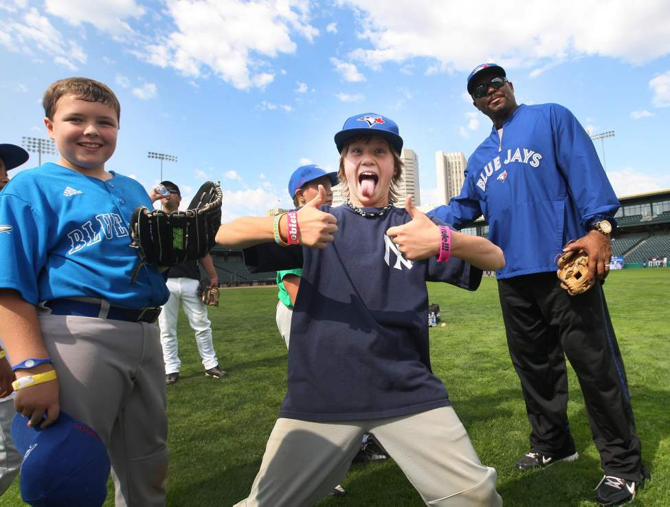 Luc Laurin (centre), 10, from the Charleswood Twins shows his excitement being next to Former Toronto Blue Jays and World Series winning outfielder Jesse Barfield at Shaw park during the Blue Jays Honda Super Camp. Thursday, August 23, 2012    (JOE BRYKSA / WINNIPEG FREE PRESS)