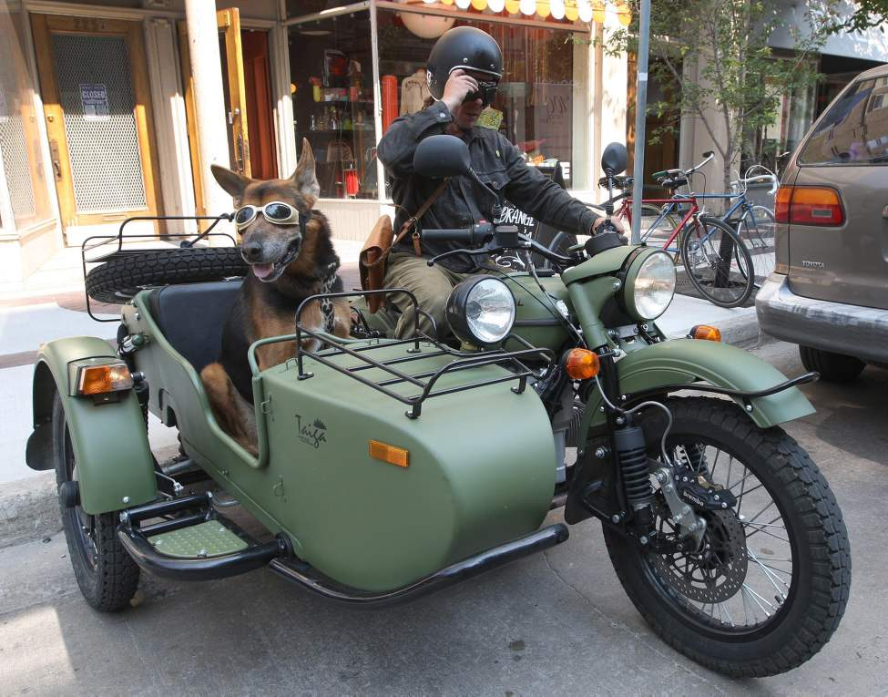 Lets Roll - Rowan Horrick gets ready to leave with his dog Doog on his  2011 Ural motorcycle and sidecar on McDermot Avenue. Thursday, August 30, 2012    (JOE BRYKSA / WINNIPEG FREE PRESS)