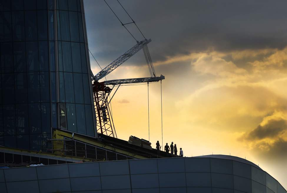 Morning Glory - Spectacular morning light cascades over the Canadian Museum for Human Rights and its construction workers at The Forks in Winnipeg. Thursday, August 28, 2012    (JOE BRYKSA / WINNIPEG FREE PRESS)