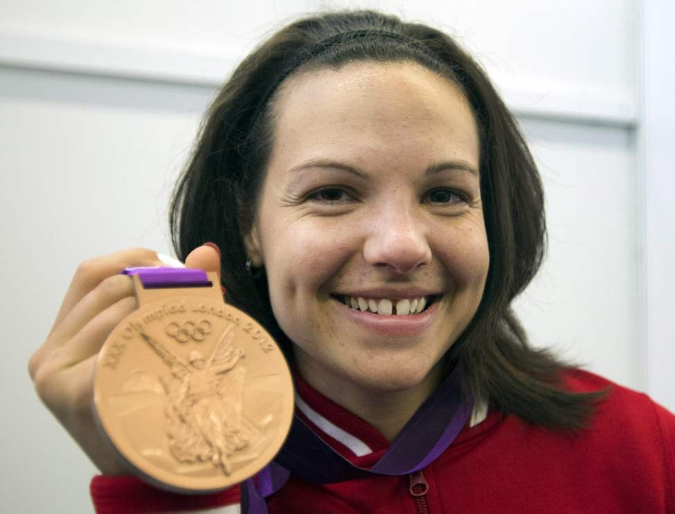 Canada's Christine Girard shows off her bronze medal in the women's 63-kg weightlifting final at the 2012 Summer Olympics.(The Canadian Press / Ryan Remiorz)