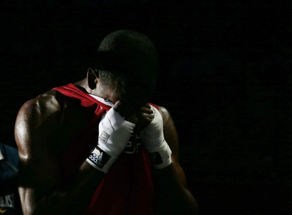 Jamel Herring, of the United States was defeated by Kazakhstan's Daniyar Yelessinov in their men's light welter 64-kg boxing match at the 2012 Summer Olympics. (AP Photo/Ivan Sekretarev)