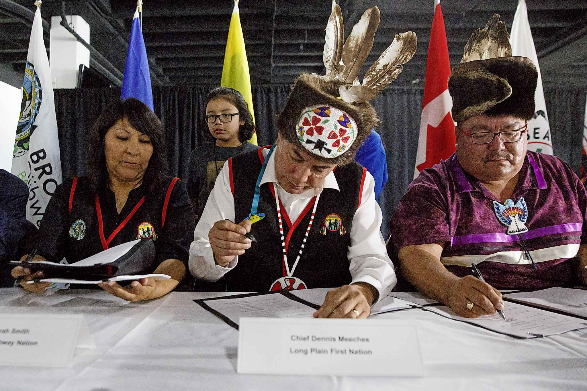 Treaty One First Nations Chiefs signing the agreement to take over the former Kapyong Barracks in August. Long Plain Chief Dennis Meeches admits many of the chiefs were caught off guard by the MMF's legal action.