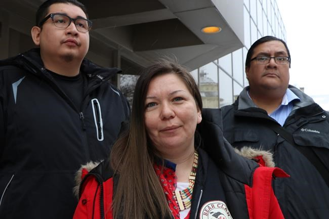 Melissa Stevenson, centre, stands outside the Winnipeg courthouse with Henry McKay, left, and Travis Bighetty after Christopher Brass was sentenced to 15 years for manslaughter in the shooting death of Stevenson's best friend, 29-year-old Jeanenne Fontaine, on Wednesday, Jan. 23, 2019. THE CANADIAN PRESS/Kelly Malone