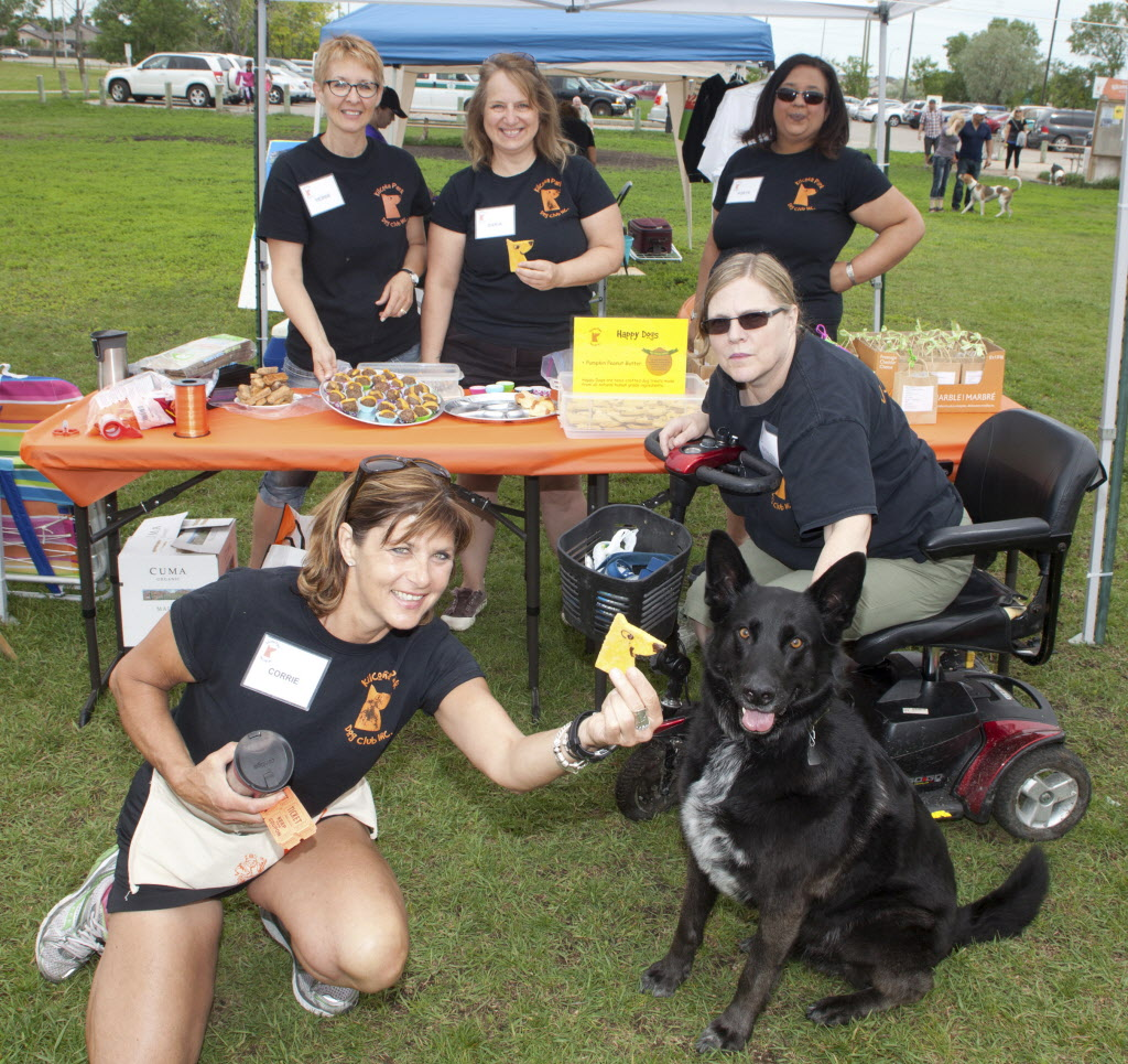 Kilcona Park Dog Club Inc. held its 10th annual fundraising barbecue on June 14, 2015. Back row (from left): Debbie Magnusson, Daria Zenchuk and Robyn Maharaj. Front row (from left): Corrie Shore and Kathleen Kirkman with her dog, Harry.  (JOHN JOHNSTON / WINNIPEG FREE PRESS)