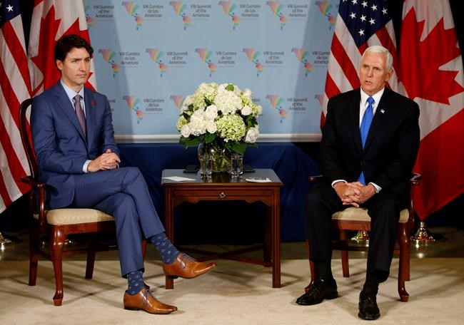 U.S. Vice President Mike Pence, right, meets Canada's Prime Minister Justin Trudeau during a bilateral meeting at the Summit of the Americas in Lima, Peru, Saturday, April 14, 2018. (AP Photo/Karel Navarro)