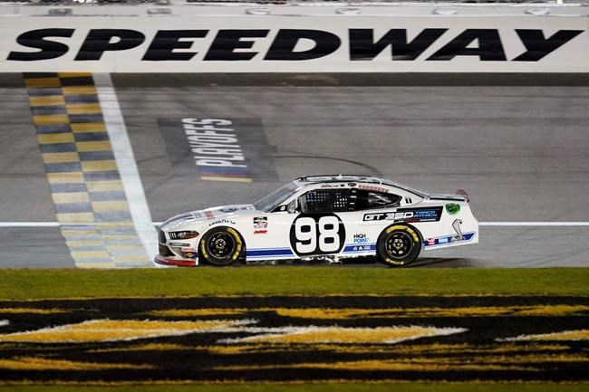 Chase Briscoe (98) crosses the finish line to win a NASCAR Xfinity Series auto race at Kansas Speedway in Kansas City, Kan., Saturday, Oct. 17, 2020. (AP Photo/Orlin Wagner)