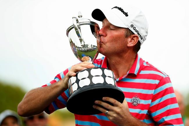 Jim Herman kisses the trophy after winning the PGA Barbasol Championship golf tournament final round at Keene Trace Golf Club's Champions Course in Nicholasville, Ky., Sunday, July 21, 2019. (Alex Slitz/Lexington Herald-Leader via AP)