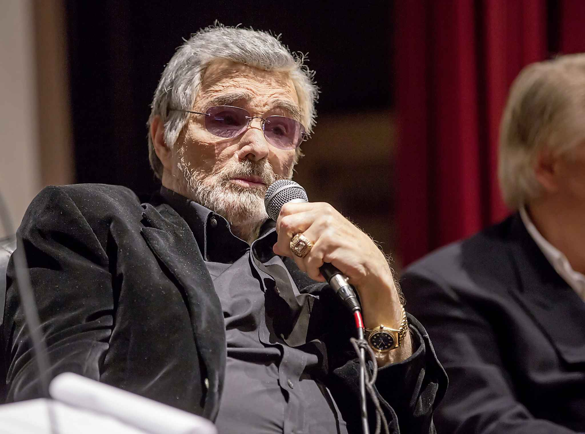 """In this Thursday, Nov. 17, 2016, photo provided by the Florida Keys News Bureau, actor Burt Reynolds answers questions during a highlight event of the Key West Film Festival in Key West, Fla. The festival honored Reynolds with its Golden Key Career Achievement Award and screened the documentary """"The Bandit"""" that explores the making of Reynolds' classic comedy motion picture """"Smokey & The Bandit."""" (Larry Blackburn/Florida Keys News Bureau via AP)"""