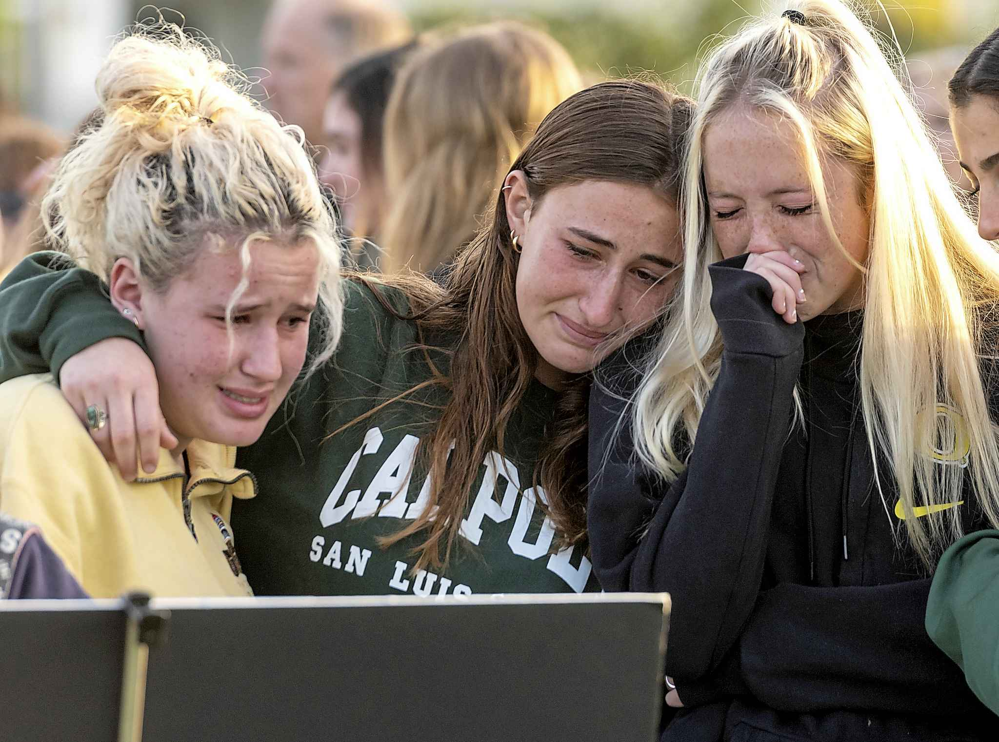 Friends and classmates of Alyssa Altobelli grieve as they look at photos of her during a vigil on Thursday. Alyssa and her parents, John and Keri Altobelli, were among the nine who died in the helicopter crash in Calabasas on Sunday. (Leonard Ortiz / The Orange County Register)