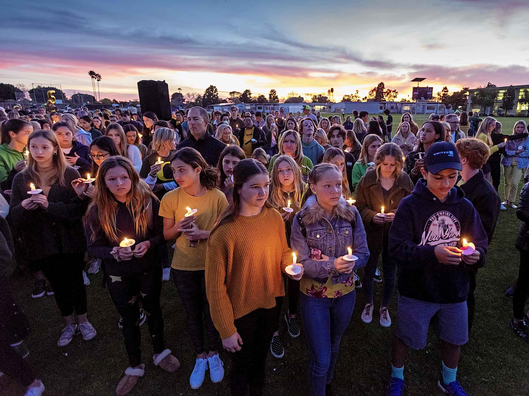 People gather for a candlelight vigil for Alyssa Altobelli and her parents in Newport Beach, Calif. on Thursday. Alyssa and her parents, John and Keri Altobelli, were among the nine who died in Sunday's helicopter crash in Calabasas. (Leonard Ortiz / The Orange County Register)