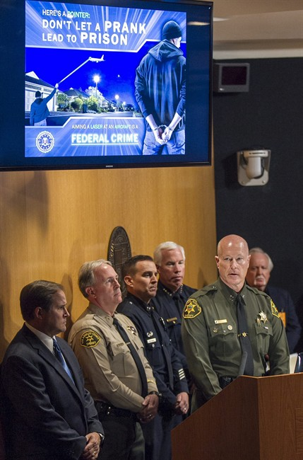 Orange County Sheriff captain Mike Hiller, right at podium, joins law enforcement agents to announce a 60-day FBI campaign