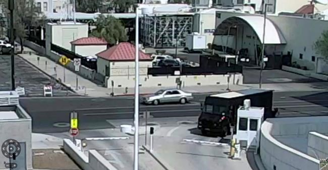 This photo from surveillance video provided by the Phoenix Police Department shows a silver sedan that authorities are seeking in connection with the wounding of a court security officer in a drive-by shooting outside the Sandra Day O'Connor federal building in Phoenix, Tuesday, Sept. 15, 2020. Police say the security officer was taken to a hospital with injuries not believed to be life-threatening. (Courtesy of Phoenix Police Department via AP)