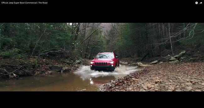 "This image made video obtained from the Jeep brand YouTube channel of Fiat Chrysler Automobiles shows part of its commercial video aired during the Super Bowl on Sunday, Feb. 4, 2018. The head of one of the nation's largest fish conservation groups says Fiat Chrysler Super Bowl ads ""glorified"" the destruction of aquatic habitat in an apparent attempt to appeal to off-road thrill seekers. (Fiat Chrysler Automobiles via AP)"