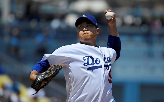 Los Angeles Dodgers starting pitcher Hyun-Jin Ryu, of South Korea, throws to the plate during the first inning of a baseball game against the Arizona Diamondbacks, Sunday, Aug. 11, 2019, in Los Angeles. (AP Photo/Mark J. Terrill)