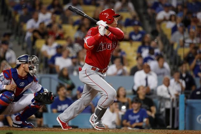 Los Angeles Angels' Shohei Ohtani, of Japan, follows through on a double during the ninth inning of a baseball game against the Los Angeles Dodgers, Friday, July 13, 2018, in Los Angeles. The Dodgers won 3-2. (AP Photo/Jae C. Hong)
