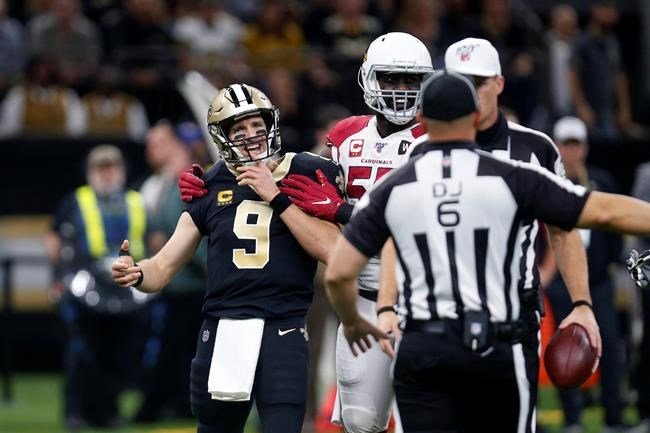 New Orleans Saints quarterback Drew Brees (9) reacts to the officials after prematurely blowing a play dead in the first half of an NFL football game against the Arizona Cardinals in New Orleans, Sunday, Oct. 27, 2019. (AP Photo/Butch Dill)