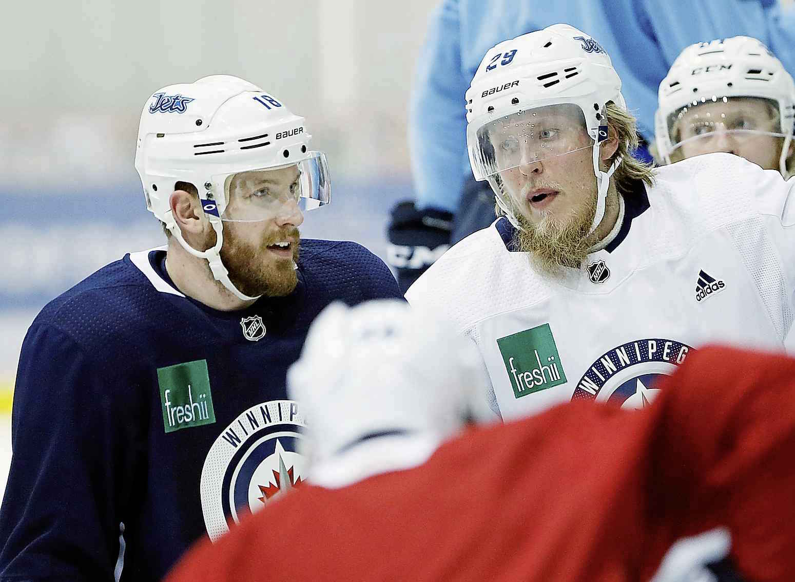 Winnipeg Jets' Bryan Little, left, and Patrik Laine during practice in Winnipeg.
