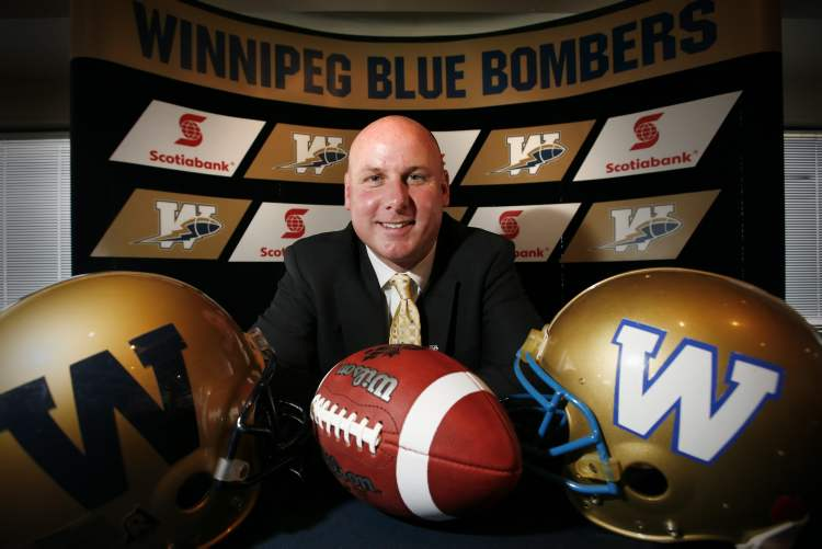 Paul LaPolice poses for a photograph after a press conference where he was announced as the 28th head coach of the Winnipeg Blue Bombers in Winnipeg, February 5, 2010. LaPolice is a former Blue Bombers offensive coordinator and won the Grey Cup with Saskatchewan in 2007. (John Woods / The Canadian Press Archives)