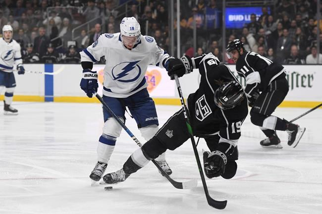 Tampa Bay Lightning left wing Ondrej Palat, left, checks Los Angeles Kings left wing Alex Iafallo during the first period of an NHL hockey game, Wednesday, Jan. 29, 2020, in Los Angeles. (AP Photo/Michael Owen Baker)