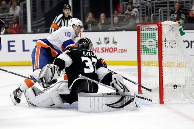 New York Islanders' Derick Brassard, top, scores past Los Angeles Kings goaltender Jonathan Quick during the first period of an NHL hockey game Wednesday, Nov. 27, 2019, in Los Angeles. (AP Photo/Marcio Jose Sanchez)