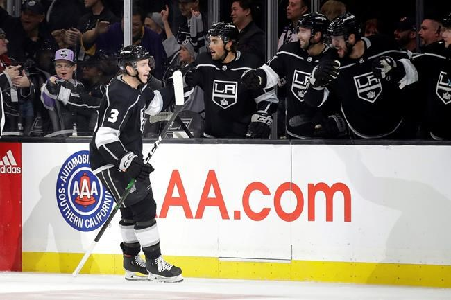 Los Angeles Kings' Matt Roy, left, celebrates his goal with teammates during the third period of an NHL hockey game against the New York Islanders on Wednesday, Nov. 27, 2019, in Los Angeles. (AP Photo/Marcio Jose Sanchez)