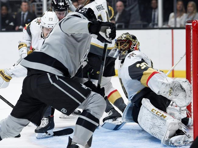 Los Angeles Kings left wing Nikolai Prokhorkin, center, shoots the puck for a goal on Vegas Golden Knights goalie Malcolm Subban during the second period of an NHL hockey game in Los Angeles, Saturday, Nov. 16, 2019. (AP Photo/Kelvin Kuo)