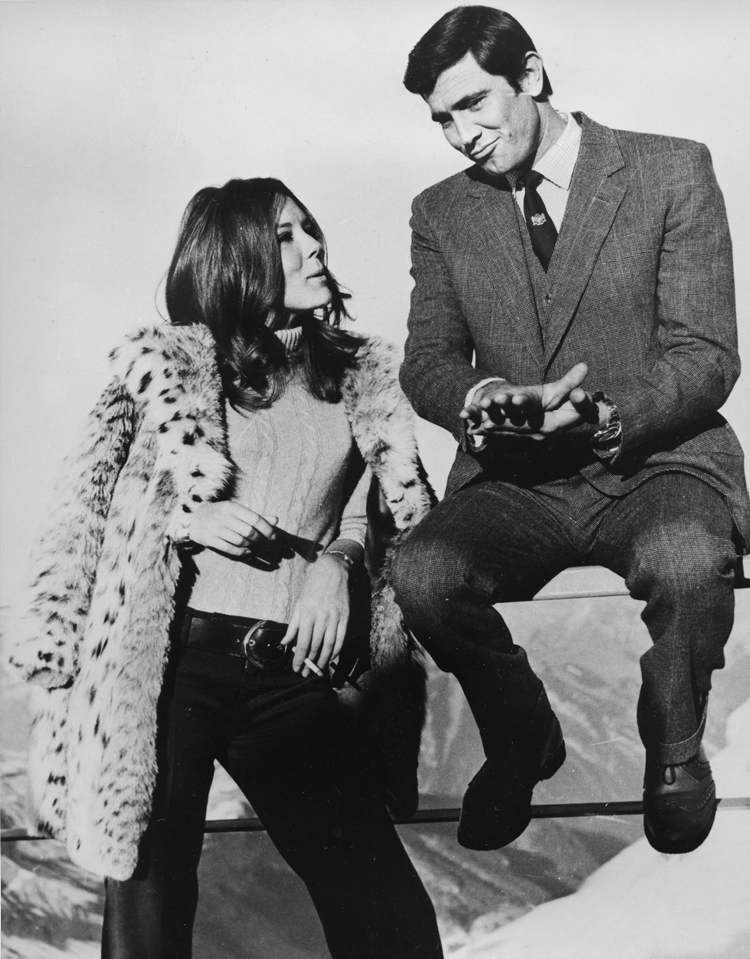 George Lazenby, right, and actress Diana Rigg as they share a moment during takes of On Her Majesty's Secret Service at Schilthorn near Muerren, Switzerland, in 1969. Along with sports cars, gadgets and sex appeal, an impeccable sense of style is a hallmark of the James Bond movie franchise.