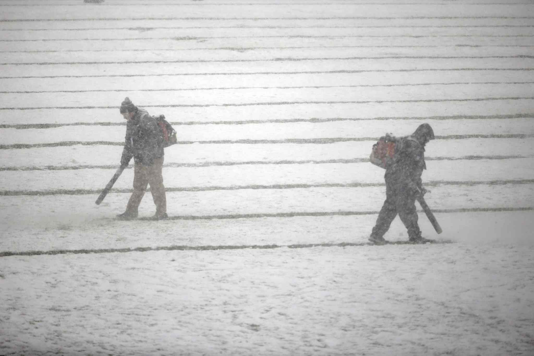 Philadelphia Eagles personnel clear snow from the field before Sunday's game between the Philadelphia Eagles and the Detroit Lions.
