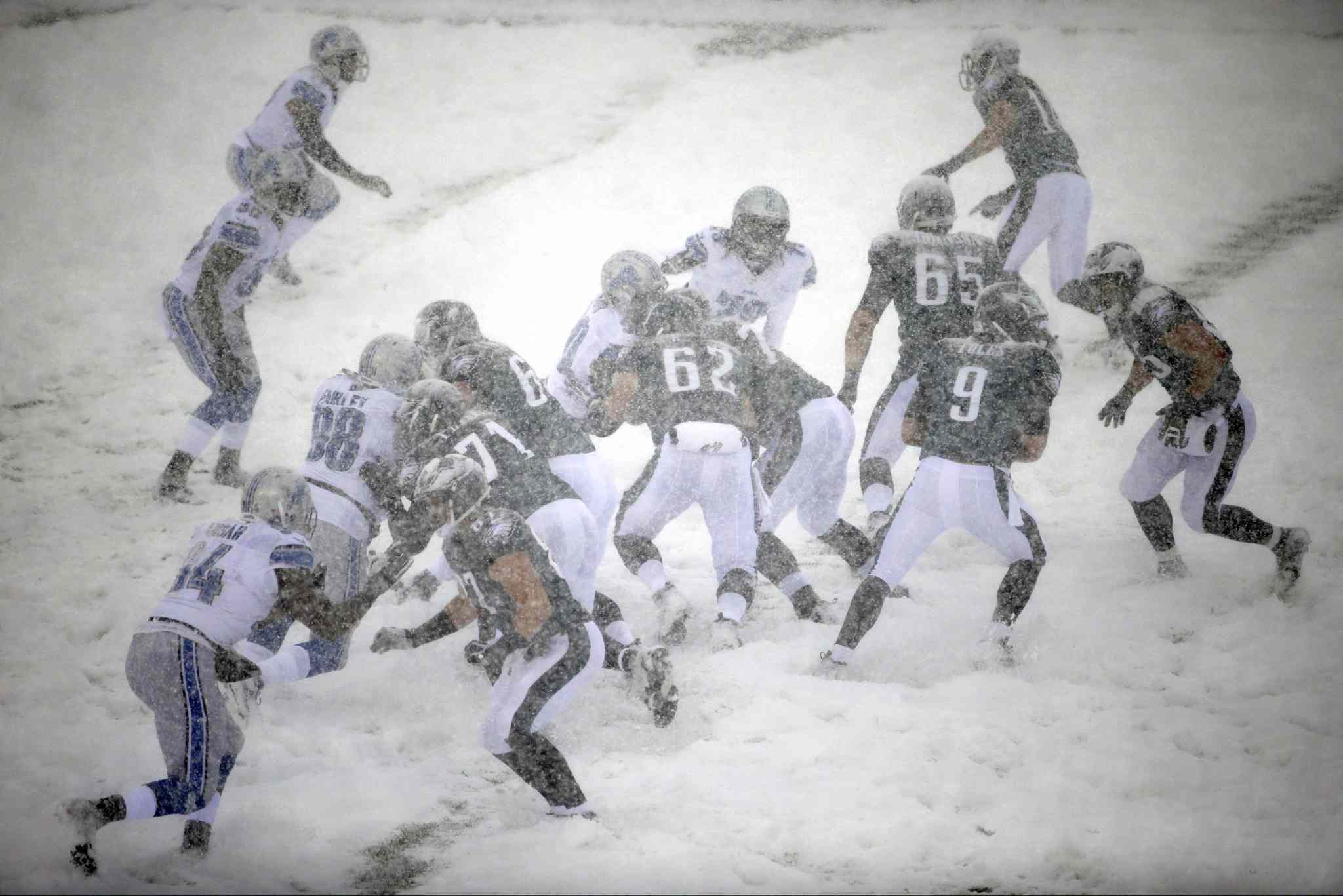 The Philadelphia Eagles and Detroit Lions battle it out in the snow in Philadelphia on Sunday.