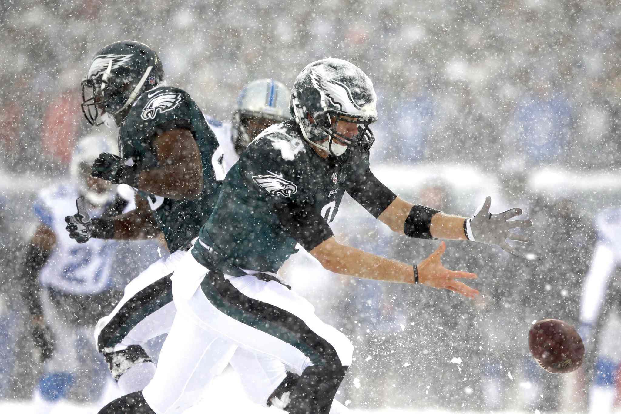 Nick Foles (centre) of the Philadelphia Eagles can't hang on to the ball during the first half of the game against the Detroit Lions.
