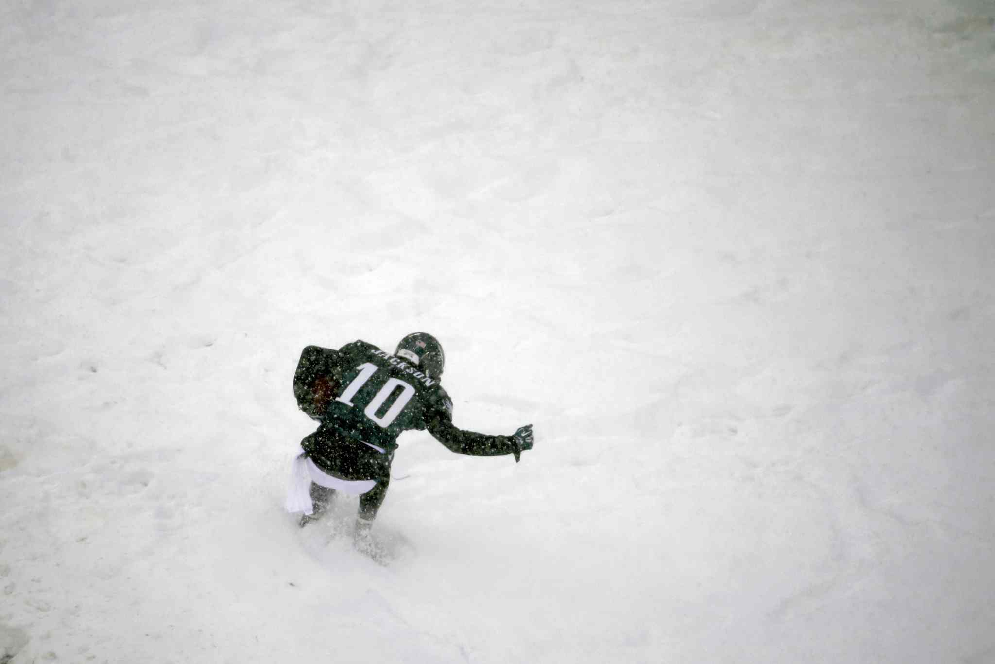 DeSean Jackson of the Philadelphia Eagles celebrates in the snow after a touchdown during the second half.